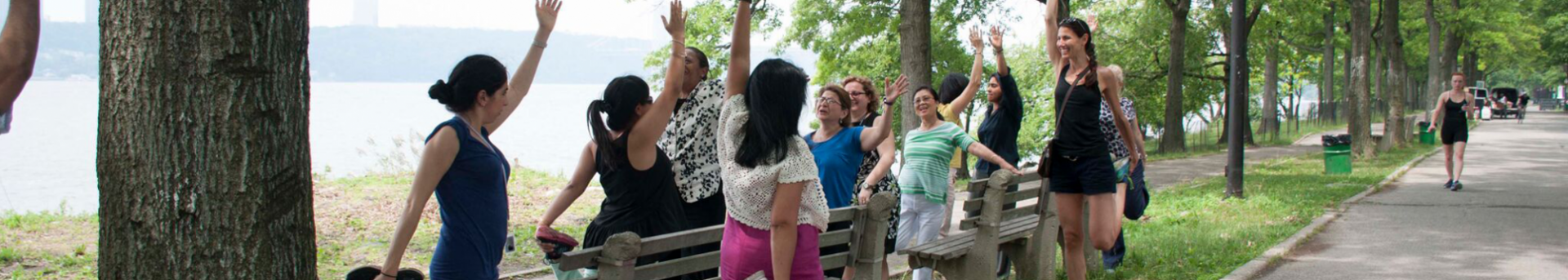 walking program participants stretching in riverside park